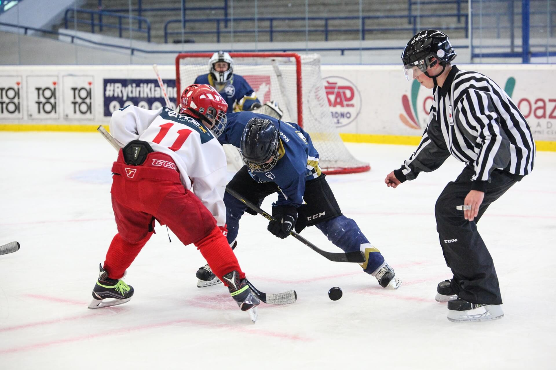 image of hockey players playing in the rink