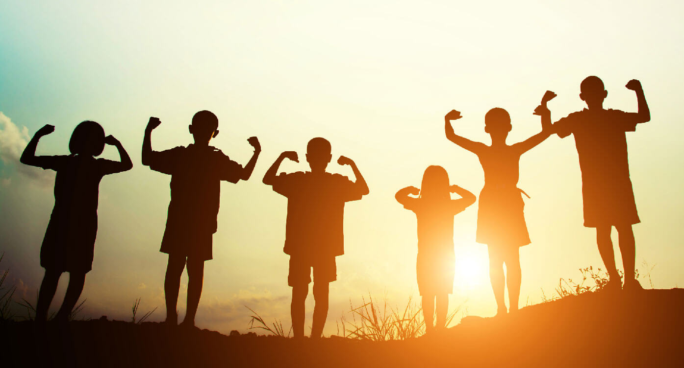 Children's silhouettes at sunset